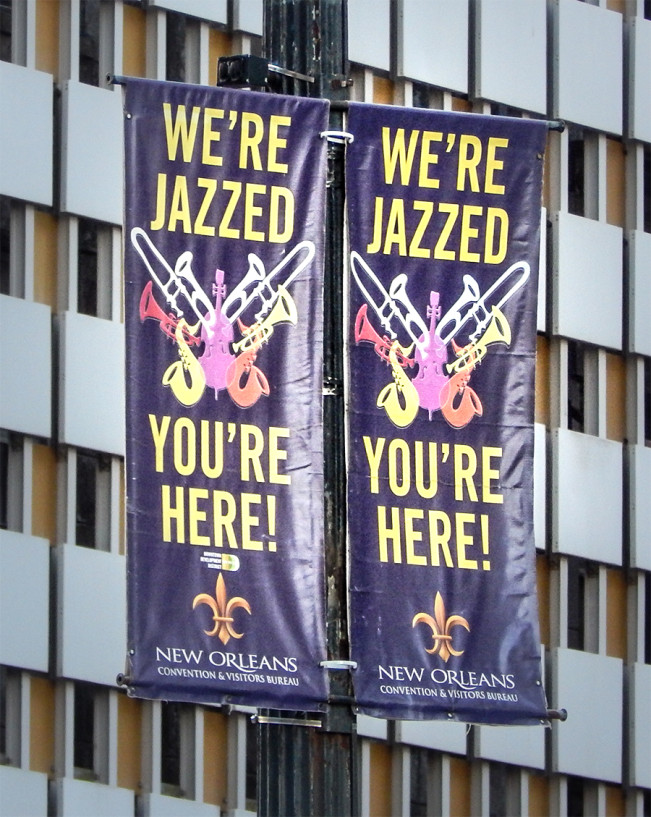 banners reading we re jazzed you re here welcome visitors to new orleans photo news 247. Black Bedroom Furniture Sets. Home Design Ideas