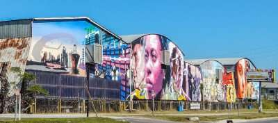 Biggest mural spans two blocks long on warehouses along Adamo Drive in Tampa FL.
