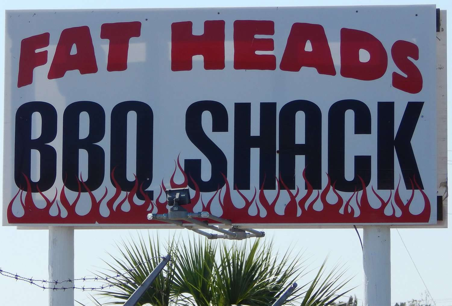Nov 16, 2014: Street sign of Fat Heads BBQ Shack, the red food truck on 41 in Apollo Beach, FL (credit Staff/photonews247.com)