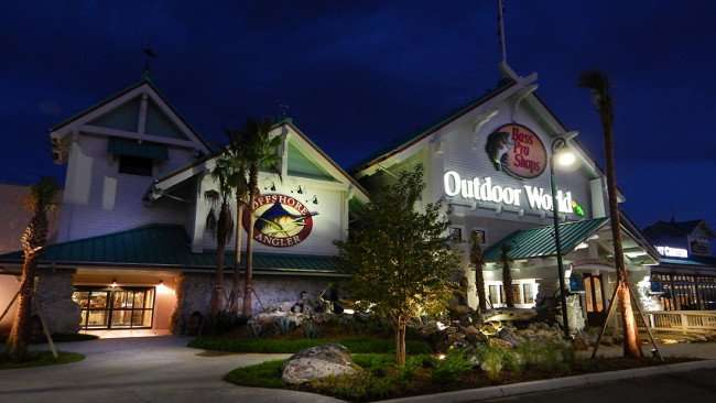 July 6, 2015 - Front entracne of Bass Pro Shops with lights on while employees stock shelves for July 29 Grand Opening, Brandon, Tampa, FL