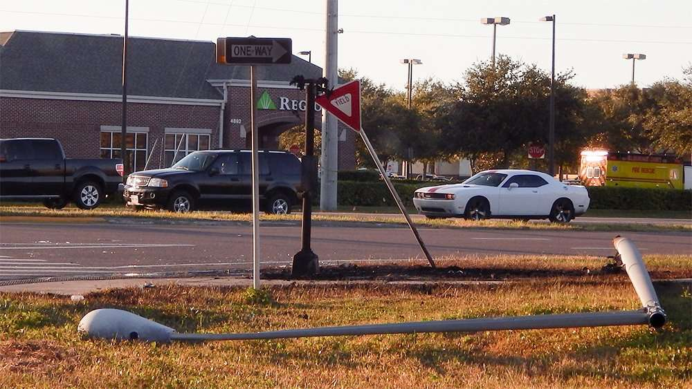 Light pole down, yield sign bent and cross walk signal light burnt at intersection 674 and 301 (Nov. 10, 2014) Wimauma FL.