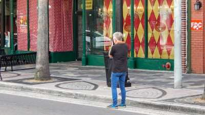Amateur photographer getting some shots down 7th Ave in Historic District of Ybor City/photonews247.com