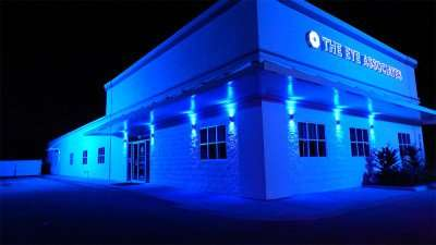 The Eye Associates building with Aurora Lighting effects at night in Sun City Center, FL