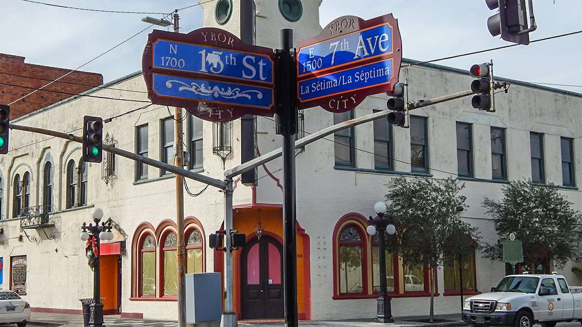 A Street sign at 15th St and 7th Ave in Ybor City with Zoya Hookah Lounge in the background /photonews247.com