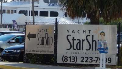 Banners advertise Starship Yacht Dining Cruises on Channelside Drive in the Channel District of Tampa, FL/photonews247.com