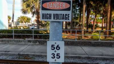 'Danger High Voltage' sign by cable car depot on Channelside Dr in Tampa, FL/2014 photonews247.com