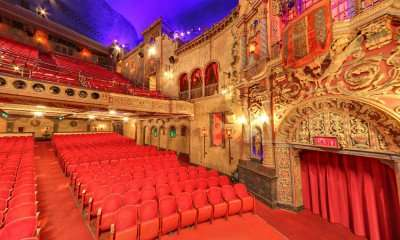 Historic Tampa Theater floor and balcony seating and exit door/ Image Capture 2014 copyright Google