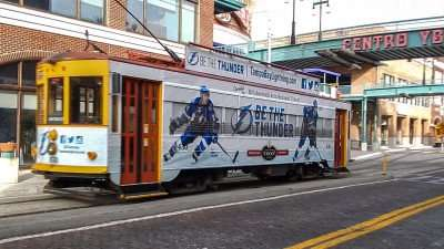 Street car with Tampa Bay Lightning advertisement on the side, riding through Ybor City/photonews247.com