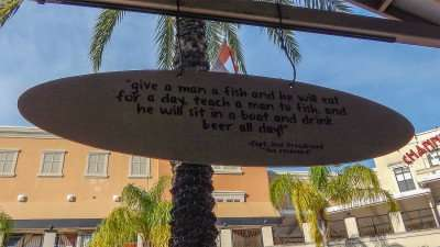'Teach a man to fish' sign in bar at Channelside Plaza, Tampa, FL/photonews247.com