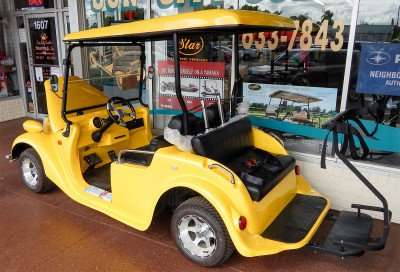 Yellow Roadster 2 + 2 seat golf cart by STARev/photonews247.com
