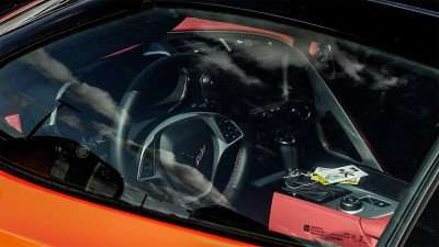 inside look through rolled up window of 2015 Chevrolet Corvette Stingray Coupe 3LT