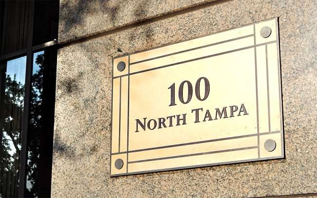 AUG 23, 2015 - Brass plate that reads 100 NORTH TAMPA on Regions Gothic building, Tampa, FL/photonews247.com