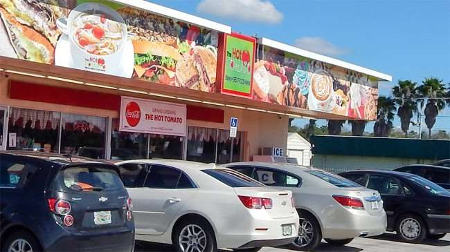 Cars filling up spaces at The Hot Tomato Bakery in Ruksin, FLorida/2015 photonews247.com