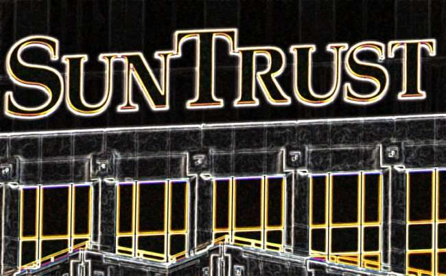 NOV 8, 2015 - Close up of top of SunTrust building with logo, Tampa, FL (glow effects filter used)/photonews247.com