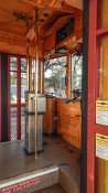 Inside of the antiquated cable car showing the drivers seat, radio and dash board/2015 photonews247.com