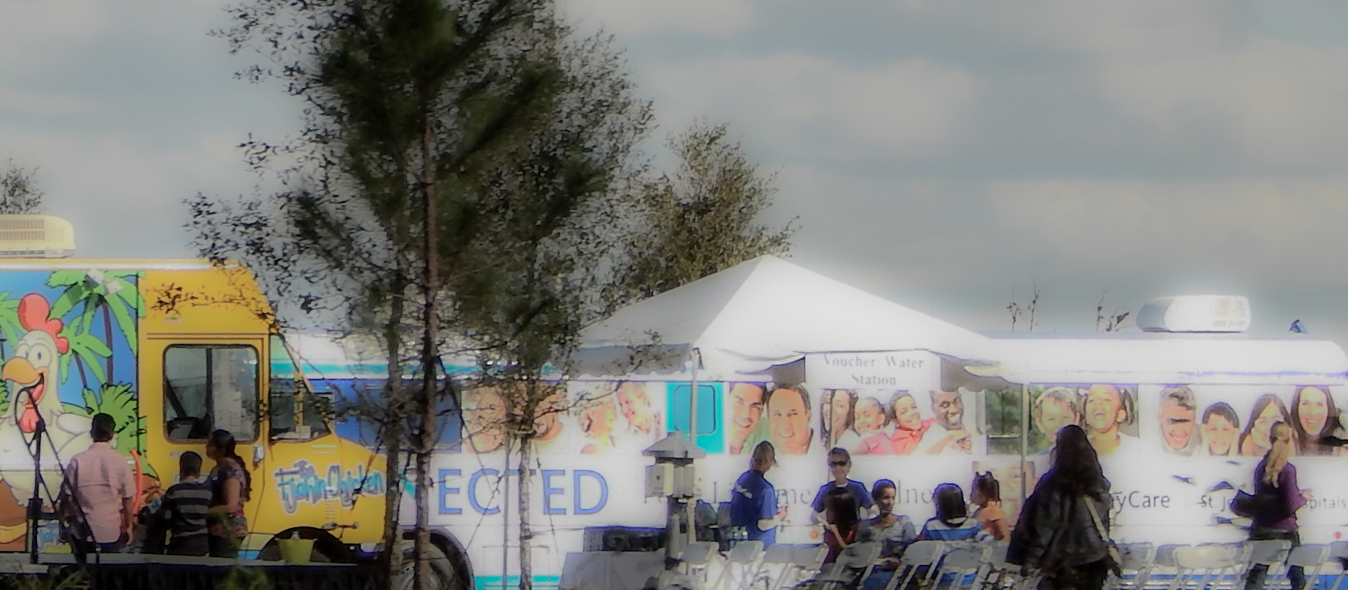 Blurred for privacy: People standing by Chicken Food Truck and at the Water Station at 2015 Open House at St Josephs Hospital-South in Riverview, FL/ 2015 photonews247.comBlurred for privacy: People standing by Chicken Food Truck and at the Water Station at 2015 Open House at St Josephs Hospital-South in Riverview, FL/ 2015 photonews247.com