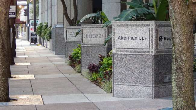 AUG 9, 2015 - Sidewalk at SunTrust Downtown Tampa with Akerman LLP and Gray Robinson engraved in stone/photonews247.com