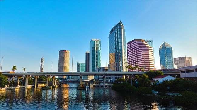 AUG 9, 2015 - Tampa Buildings reflecting of Hillsborough River from Platt St Bridge, Downtown Tampa, FL/photonews247.com