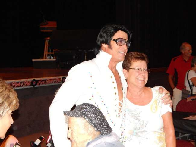 Billy Lindsay, Elvis impersonator, with arm around fan getting picture taken at the Borini Theatre at Kings Point Club House, Sun City Center/photonews247.com