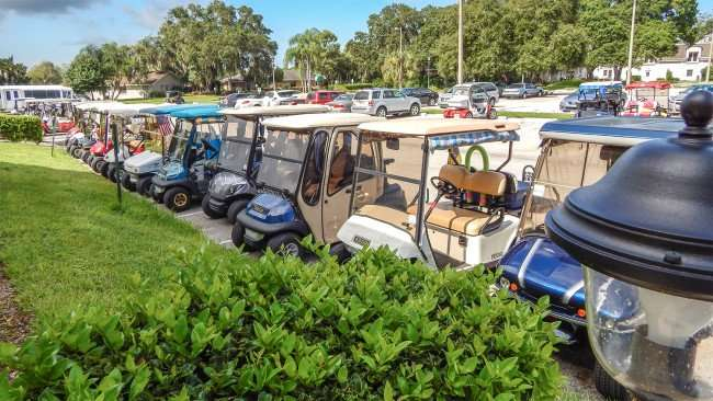 Front row parking for golf carts and Kings Point Main Clubhouse, Sun City Center/photonews247.com