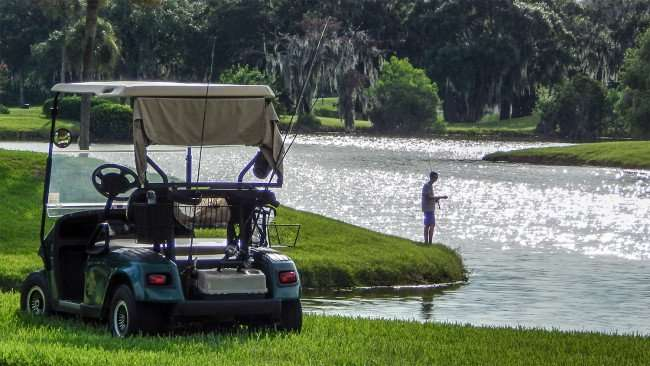 July 26, 2014 - gentleman drives golf cart to fishing pond in Kings Point/photonews247.com