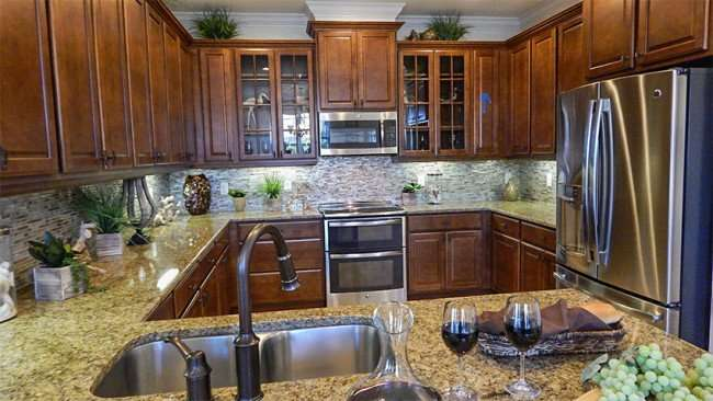 Kitchens (wooden cabinets) in Renaissance Verona new gated neighborhood, Sun City Center