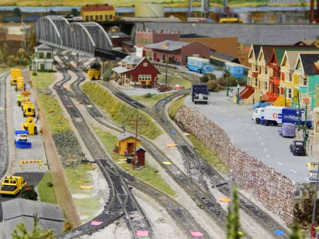 Miniature train city with construction site and bridge created by Kings Point Model Railroad Club in Sun City Center, Florida/photonews247.com