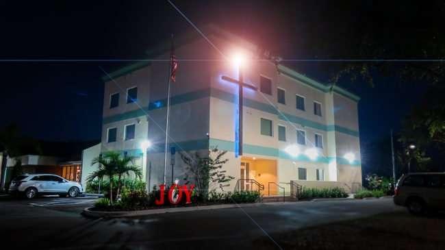 Dec 28, 2016 - Trinity Baptist Church education building with angel glowing on Cross, Sun City Center, FL/photonews247.com