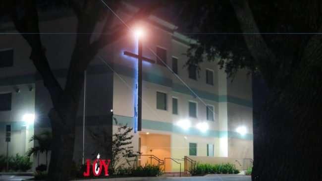 Dec 28, 2016 - Trinity Baptist Church school house with glowing angel on cross at night Sun City Center, FL/photonews247.com