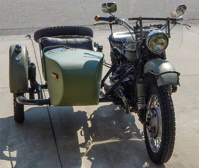 Antique Green Army Military motorcycle with sidecar