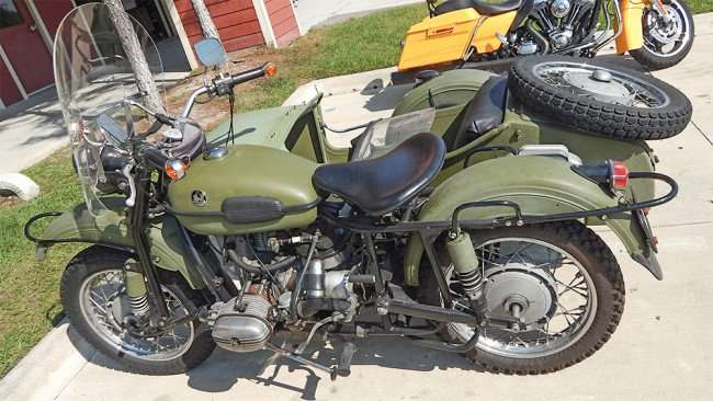Green Army motorcycle with sidecar