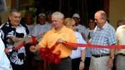 Jim Haggerty (L) President of Kings Point cuts Ribbon with Vice President Wayne Musholte (R) in yellow shirt for 2020 Center, Kings Point, Sun City Center, FL/2015 photonews247.com