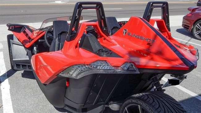 Rear of red Polaris Slingshot three wheel motorcycle/2015 photonews247.com