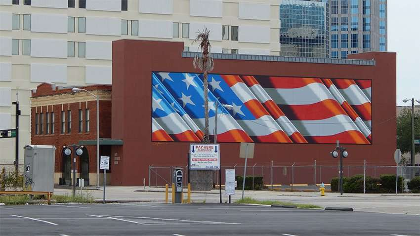 80 foot American Flag mural painted by Scott LoBaido on Tampa Firefighters Museum