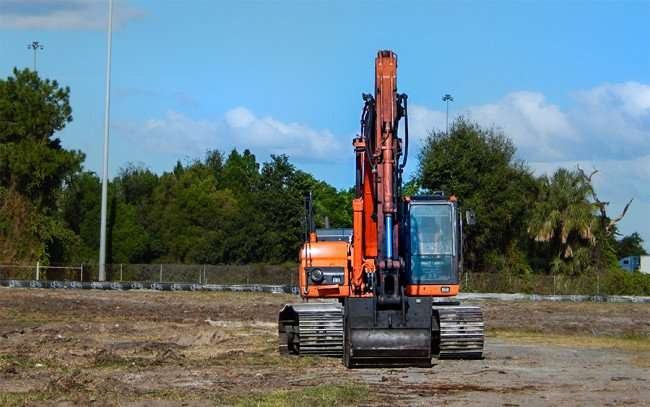 OCT 24, 2015 - Excavator finishes clearing field for RIVERVIEW 14 SCREEN THEATER along Hwy 75 in Gibsonton, FL/photonews247.com