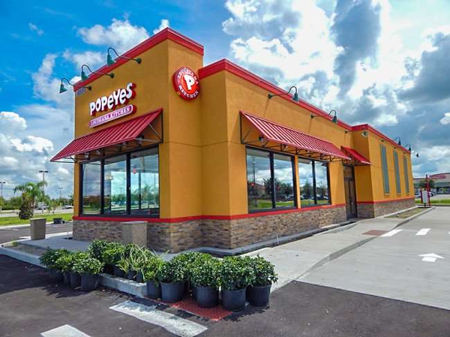SEPT 26, 2015 - Landscape company adding plants to Popeyes Riverview on Big Bend/photonews247.com