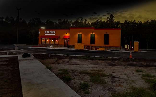 NOV 7, 2015 - Popeyes Chicken parking lot paved with lights on Sun City Center, FL/photonews247.com