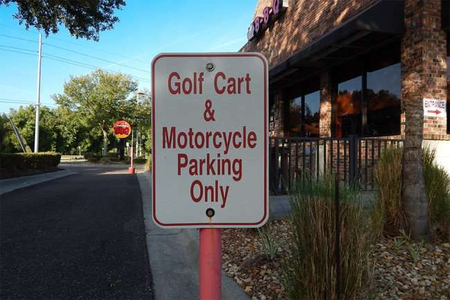 May 5, 2015: Bubba Ques Sun City Center-Ruskin has exclusive parking for golf carts and motorcycles/2015 photonews247.com