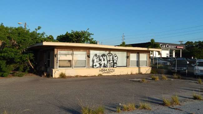 MAY 10, 2015: 'LAF' graffiti art painted on delapidated Paramount Pools building in Ruskin South Shore, FL/Photo News 247