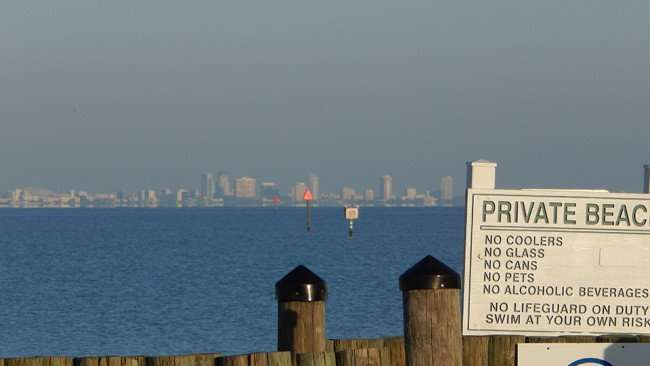 MAY 10, 2015: Private beach in Ruskin South Shore, FL with St Petersburg in background / Photo News 247