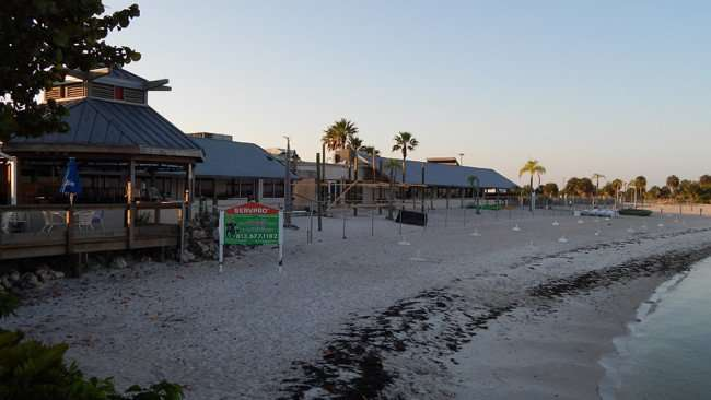 MAY 10, 2015: A view of private beach being renovated from the pier at Sunset Grille in Little Harbor, Ruskin South Shore, FL / Photo News 247
