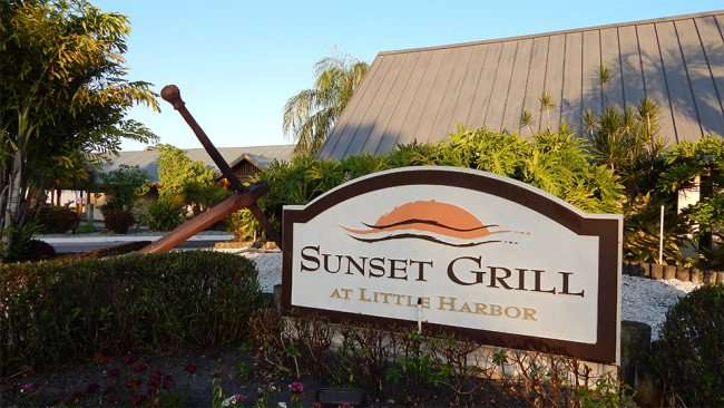 MAY 10, 2015: Front sign and building of Sunset Grill at Little Harbor in Ruskin South Shore, FL / Photo News 247