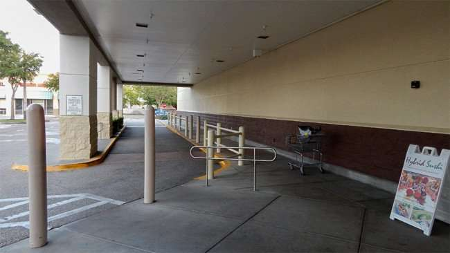 MAY 11, 2015: pickup and drop off lane with roofed portico at Publix Super Market, Kings Crossing, Sun City Center FL / Photo News 247
