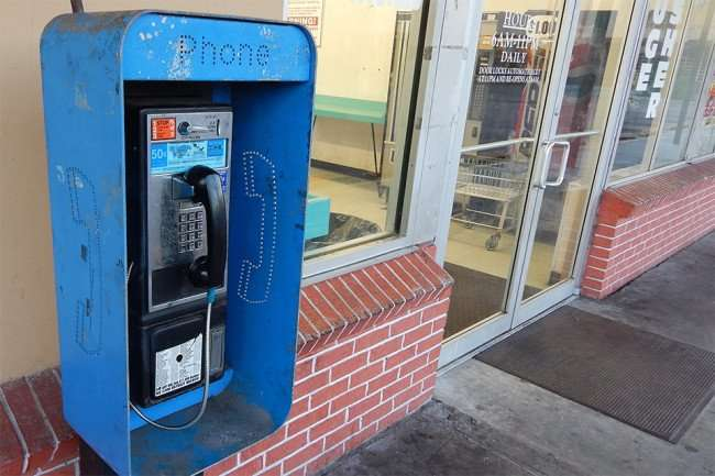 MAY 12, 2015: A working payphone at a coin laundry mat in Twin Oaks Plaza on Us Hwy 41, Gibsonton South Shore, FL