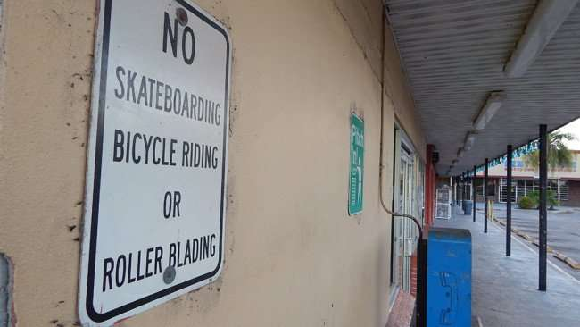 MAY 12, 2015: Sign - NO SKATEBOARDING, BYCYCLE RIDING OR ROLLER BLADING in shopping center, Gibsonton South Shore, FL / Photo News 247