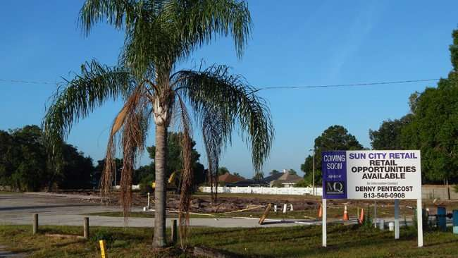 MAY 13, 2015 - MQ Development Partners sign next to palm tree in demolished Village Plaza, Wimauma, FL