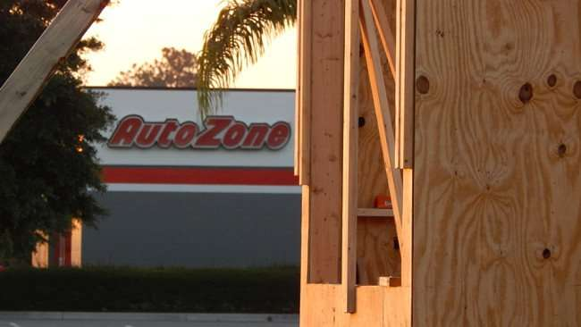 MAY 14, 2015 - Wooden structure with Auto Zone in background at Winn Dixie on Big Bend, Riverview South Shore, FL