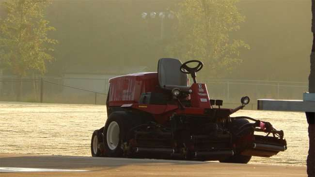 MAY 15, 2015 - Toro riding lawn mower in morning sun at The Family Y at Big Bend, Gibsonton, FL