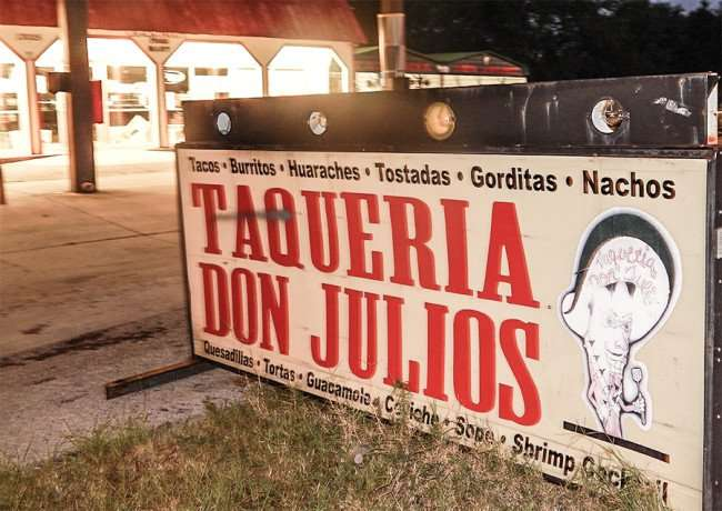 MAY 16, 2015 - Road sign for TAQUERIA DON JULIOS mexican food truck restaurant on US 301, Riverview South Shore, FL