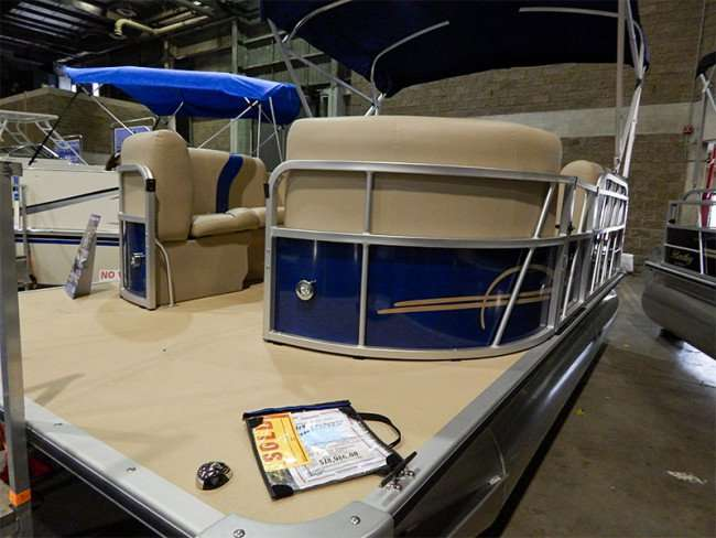 MAY 17, 2015 - 18 foot Bentley blue pontoon boat sold, Tampa Bay Boat Show 2015, Expo Hall at Florida State Fairgrounds